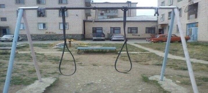cursed_image-swingset with two ropes