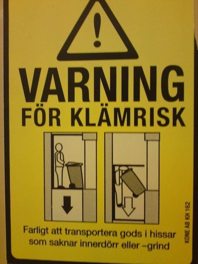 Signage - VARNING FÖR KLÄMRISK Farligt att transportera gods i hissar som saknar innerdörr eller-grind KONE AB KH 162