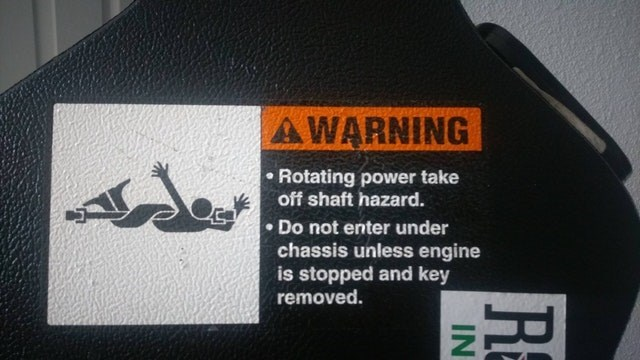 Font - AWARNING Rotating power take off shaft hazard. Do not enter under chassis unless engine is stopped and key removed.