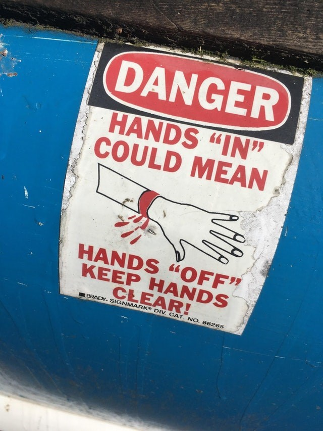 "Advertising - DANGER HANDS ""IN"" COULD MEAN HANDS ""OFF"" KEEP HANDS CLEAR! BRADY. SIGNMARK DIV. CAT. NO. 86265"