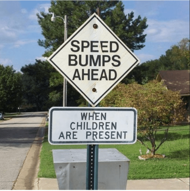 Sign - SPEED BUMPS AHEAD WHEN CHILDREN ARE PRESENT