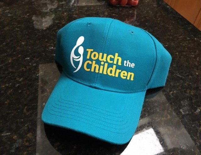 Cap - Touch the Children