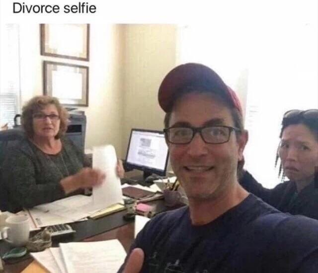 Divorce selfie with a guy looking happy and his ex-wife looking sad