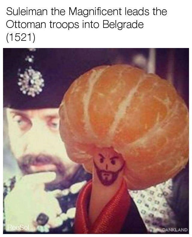 "Pic of a finger in an orange hat with the caption, ""Suleiman the Magnificent leads the Ottoman troops into Belgrade (1521)"""