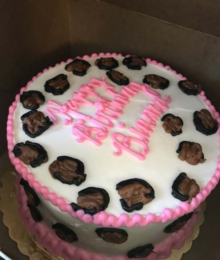 Birthday cake with brown spots all over it