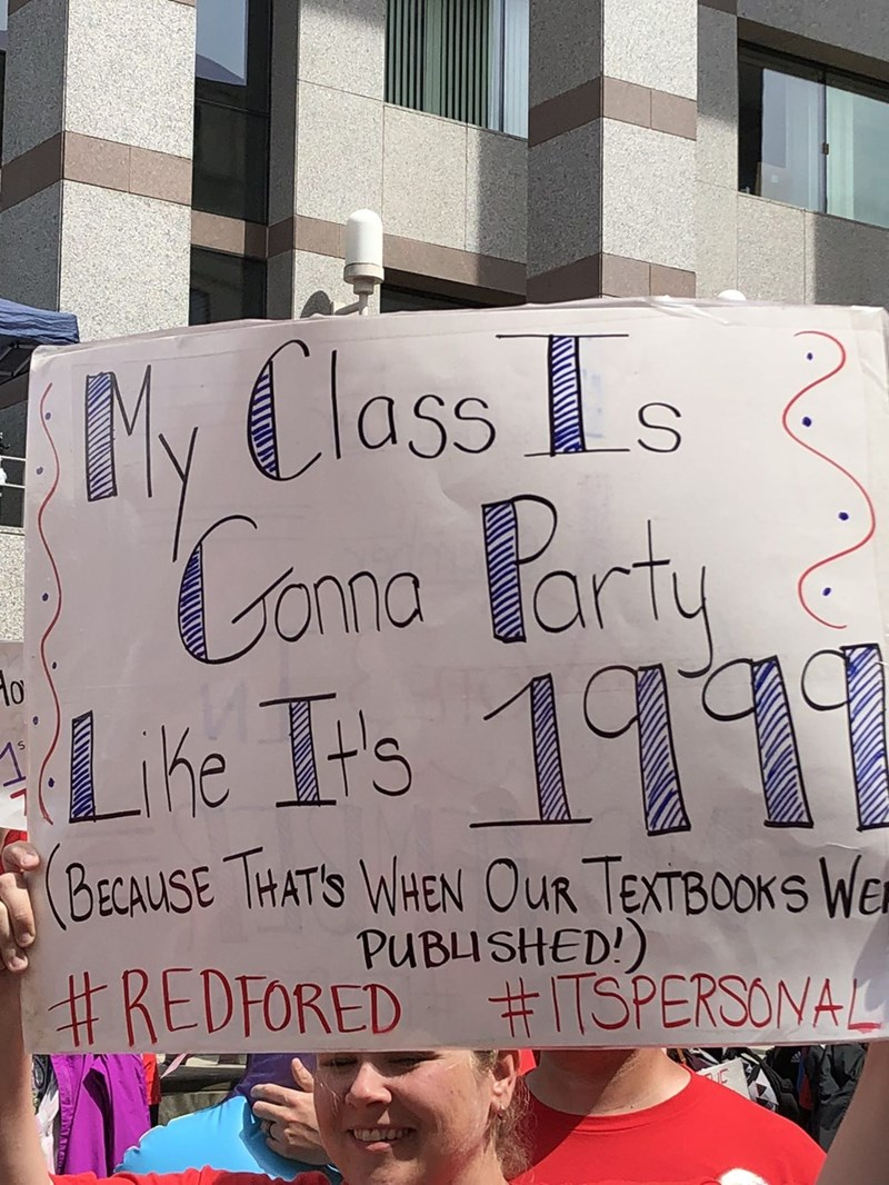 """Protest sign that reads, """"My class is gonna party like it's 1999 (because that's when our textbooks we published)"""""""