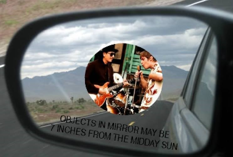 Rear-view mirror - OBJECTS IN MIRROR MAY BE INCHES FROM THE MIDDAY SUN