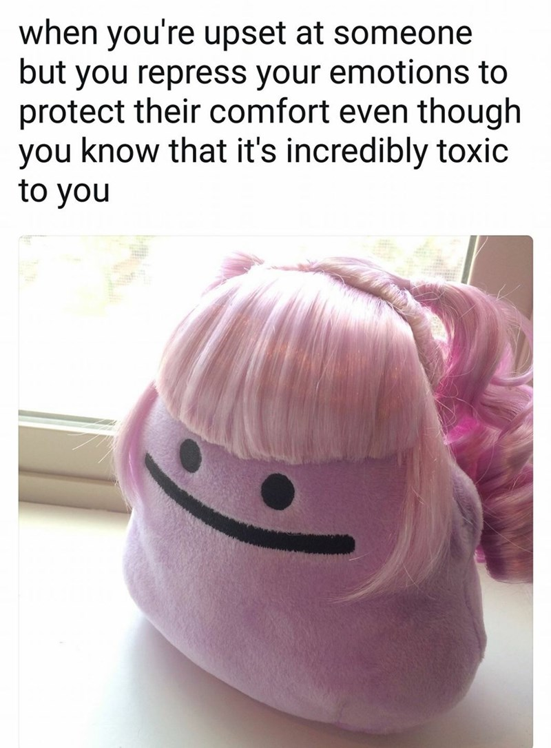 meme about repressing your emotions with pic of a Ditto Pokemon toy with a pink wig