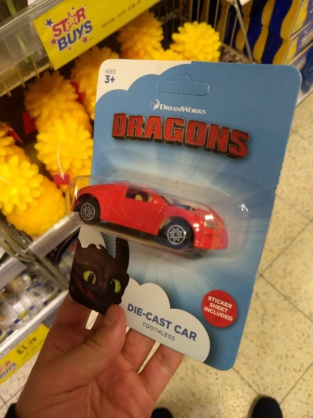 Toy vehicle - STAR BUYS PO r AGES 3+ DREAMWORKS OR:AGONS STICKER SHEET INCLUDED DIE-CAST CAR TOOTHLESS S1.79 SUYS
