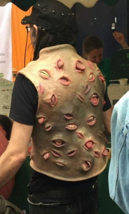 cursed image - a jacket with mouths all over it