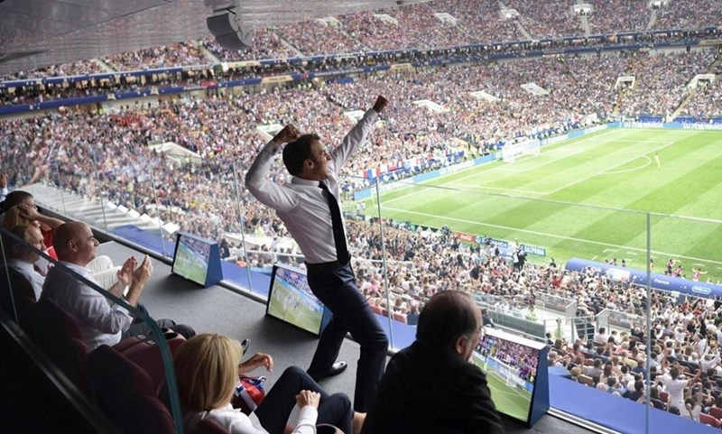 Original photo of Macron celebrating France's World Cup win by waving his arms