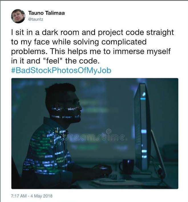 """Picture of a guy working on his computer in the dark with the caption, """"I sit in a dark room and project code straight to my face while solving complicated problems. This helps me to immerse myself in it and 'feel' the code"""""""