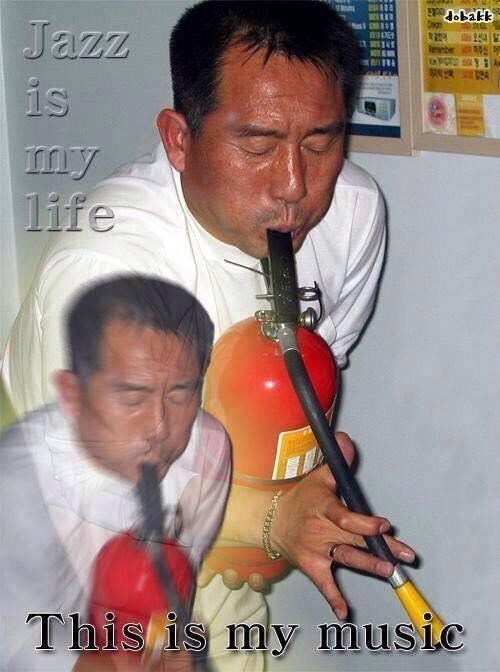 meme about jazz with picture of man playing fire extinguisher like it's a saxophone