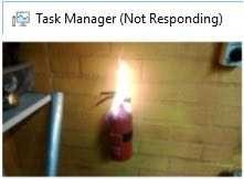 meme about the task manager program freezing with picture of fire extinguisher burning in flames