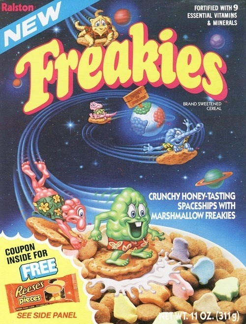 Fictional character - Ralston FORTIFIED WITH 9 ESSENTIAL VITAMINS EV Freakies &MINERALS BRAND SWEETENED CEREAL CRUNCHY HONEY-TASTING SPACESHIPS WITH MARSHMALLOW FREAKIES COUPON INSIDE FOR FREE Reeses pieces SEE SIDE PANEL AETWT. 11 OZ. (311g)