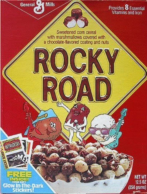 Breakfast cereal - General Mills Provides 8 Essential Vitamins and Iron Sweetened com cereal with marshmallows covered with a chocolate-flavored coating and nuts ROCKY ROAD M1RAGEOS FREE INSIDE! Clow In-The-Dark Stickers! NET WT 12.5 0Z (354 grams