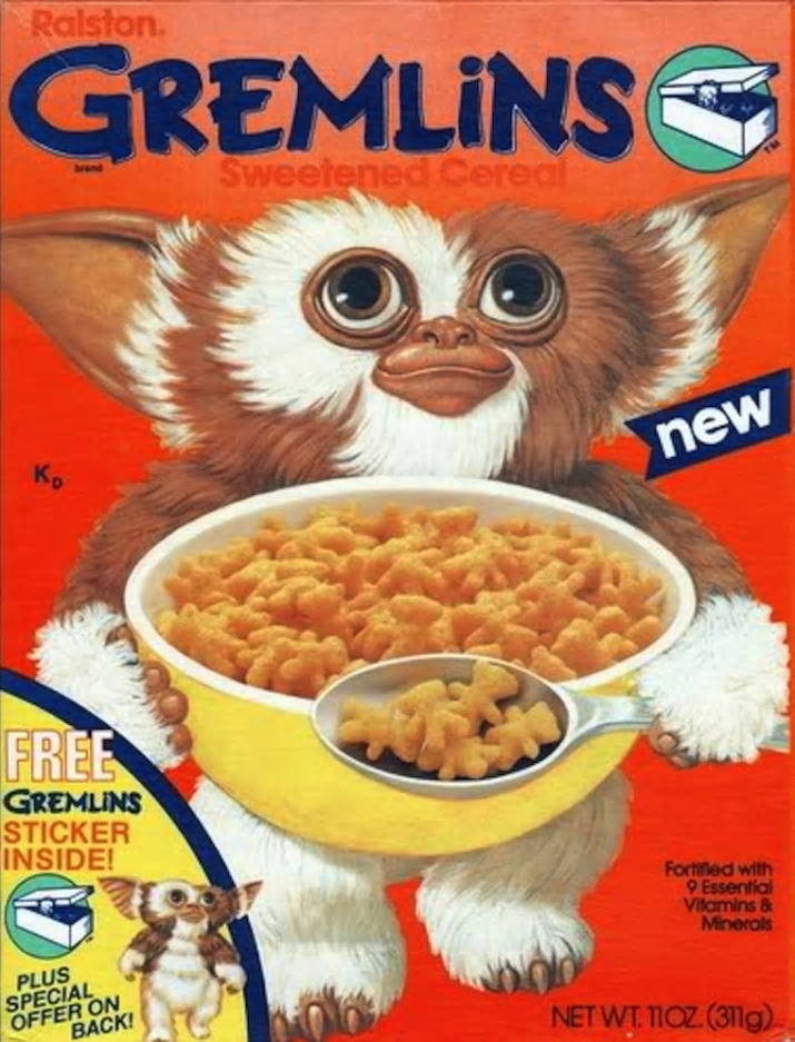 Breakfast cereal - Ralston. GREMLINS Sweetened Cereal nd new Кр FREE GREMLINS STICKER INSIDE! Fortifled with 9 Essential Vilamins& Minerals PLUS SPECIAL OFFER ON BACK! NET WT. 11OZ.(311g)