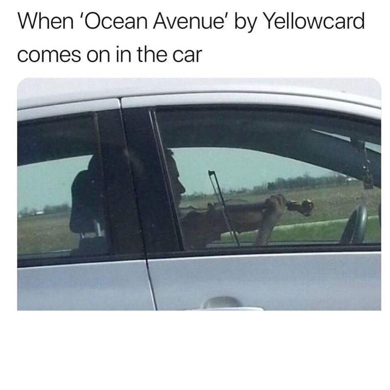 Wednesday meme of man playing violin while driving
