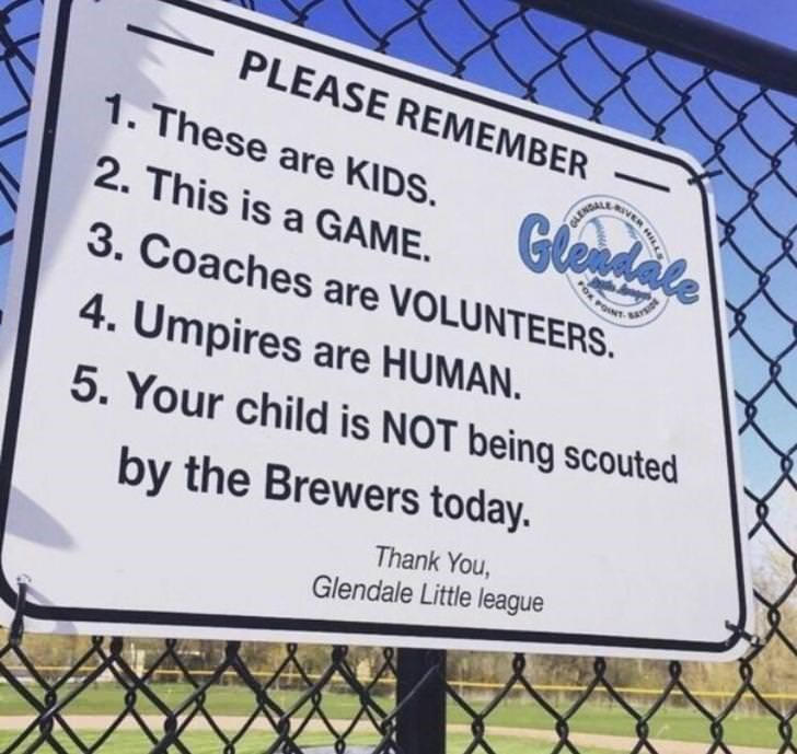 Text - PLEASE REMEMBER 1. These are KIDS. 2. This is a GAME. Gleadate 3. Coaches are VOLUNTEERS. GLENGALE 4. Umpires are HUMAN. 5. Your child is NOT being scouted by the Brewers today. Thank You Glendale Little league