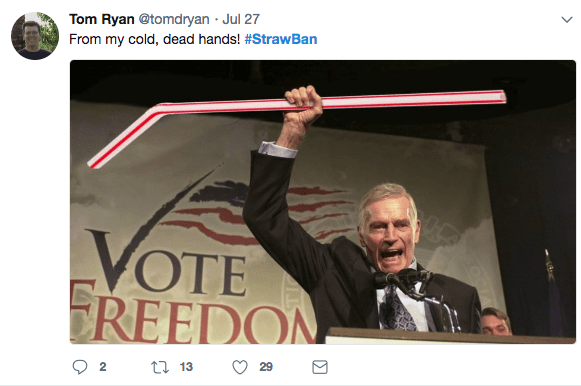 Photoshopped meme of Charlton Heston holding up a giant straw like a rifle