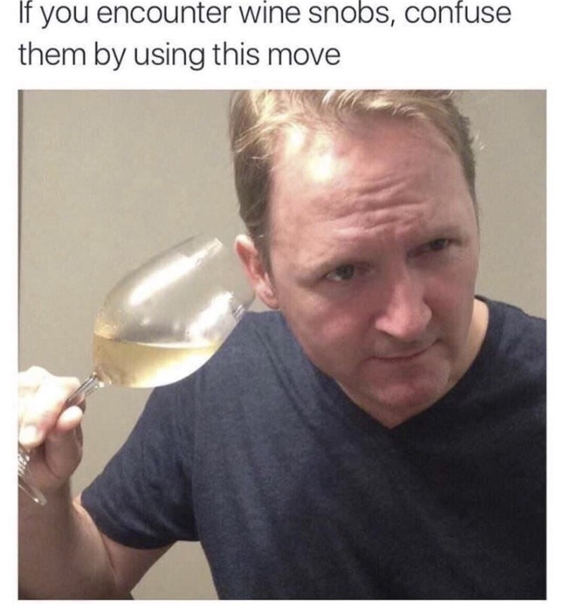 "Picture of a guy listening to his wine glass under the caption, ""If you encounter wine snobs, confuse them by using this move"""