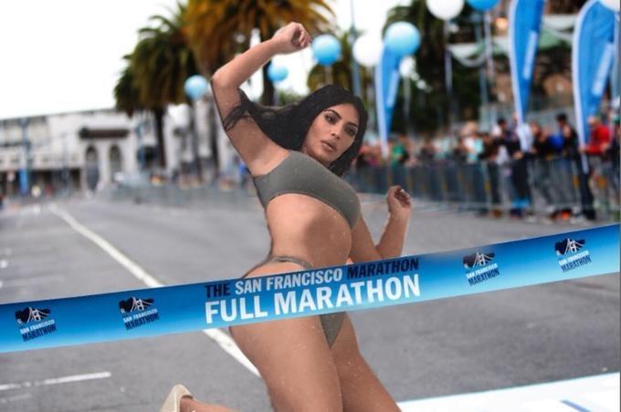 Photoshopped image of Kim Kardashian running through the finish line of a marathon