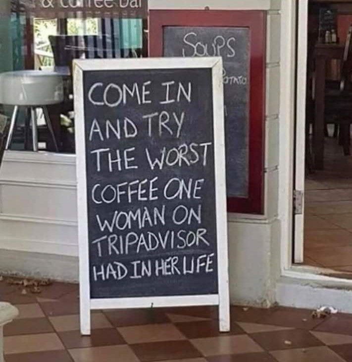 "Sign outside of a coffee shop that reads, ""Come in and try the worst coffee one woman on Trip Adviser had in her life"""