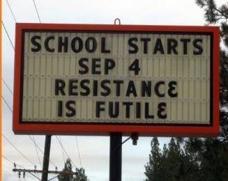 sign that says resitting going back to school is futile