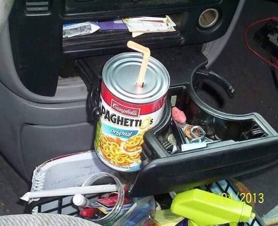 Pic of a can of Spaghetti-Os in a car with a straw coming out