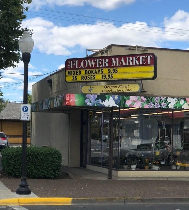 Building - FLOWER MARKET MIXED BOKAYS 9.95 25 ROSES 19.95 Oregon Floral Distributors. Inc. P AM-5PM