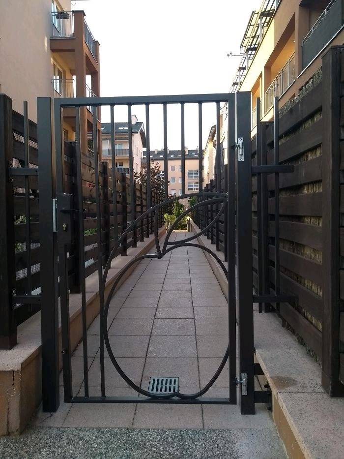 picture of gate with space between the bars large enough for person to fit through