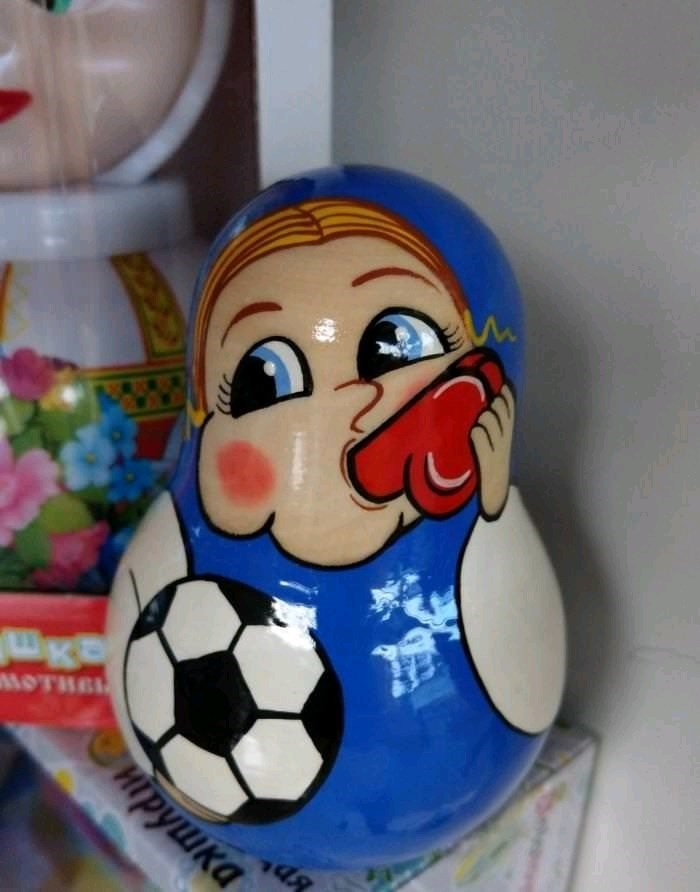 football themed babushka doll blowing whistle that looks like part of the male anatomy