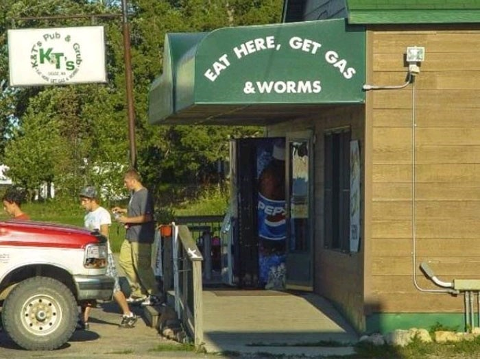 """sign for store at rest area that reads """"eat here, get gas and worms"""""""