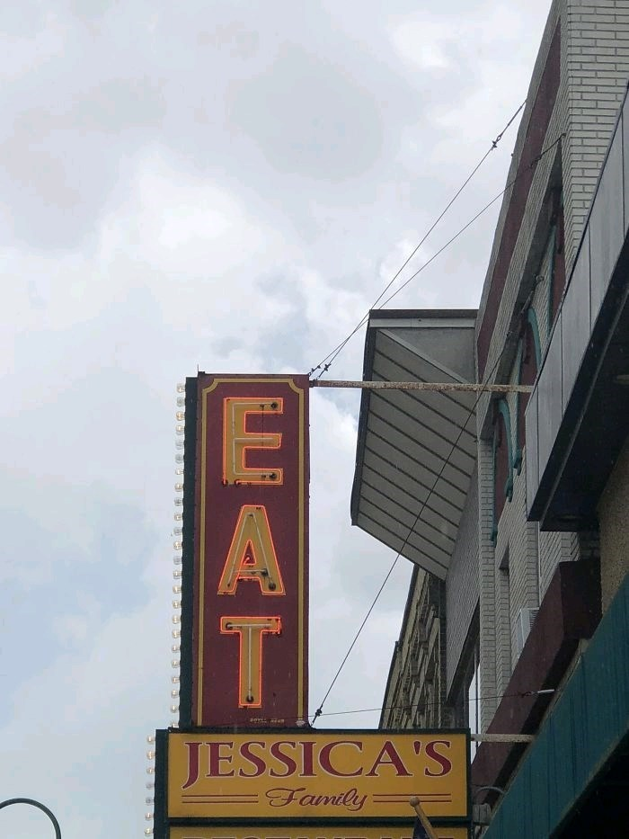 "two signs placed together to read ""eat Jessica's family"""