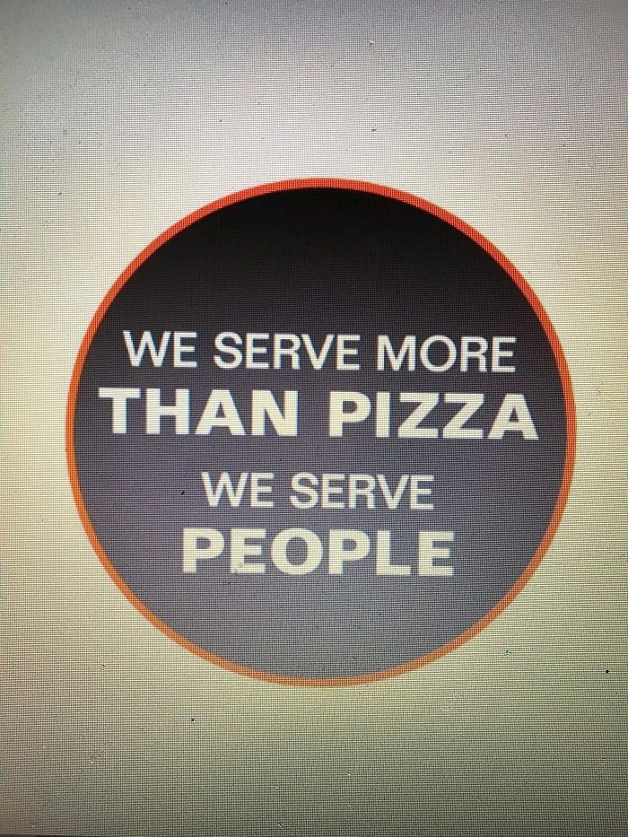 "ad for pizza place reading ""we serve more than pizza, we serve people"""