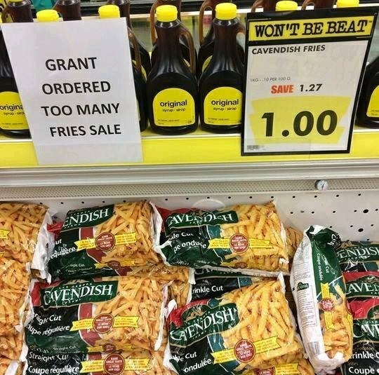 "Pic of a bunch of fries for sale at a grocery store with a sign above that reads, ""Grant ordered too many fries sale"""