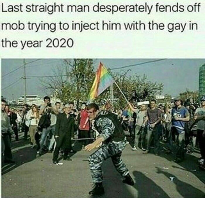 """Pic of a military guy in the middle of the circle where someone is holding a pride flag under the caption, """"Last straight man desperately fends off mob trying to inject him with the gay in 2020"""""""