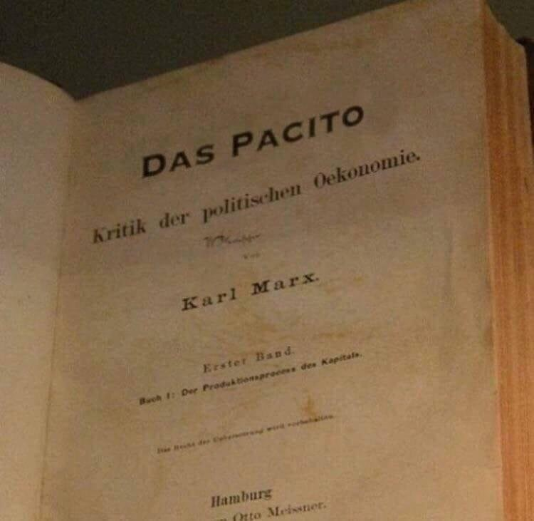 Picture of an old book written by Karl Marx called 'Das Pacito'