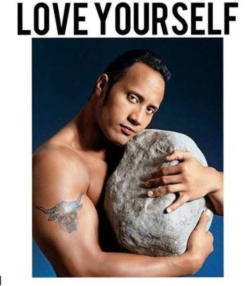 "Pic of The Rock hugging a large rock under the caption, ""love yourself"""