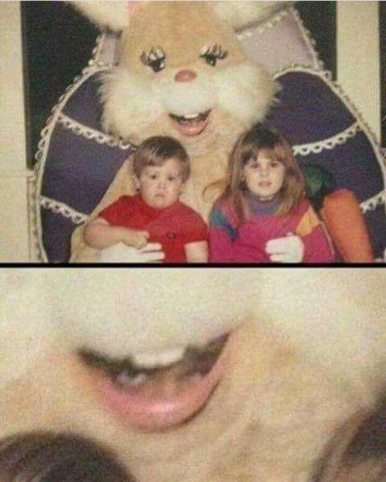 Pic of two kids sitting on a creepy Easter bunny's lap where the guy's head is peeking out through the mouth of the costume
