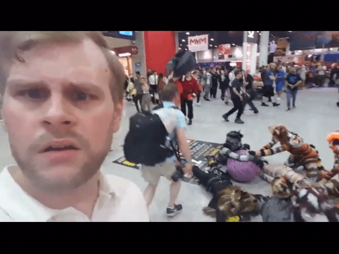 GIF - guy stumbles upon a furry convention