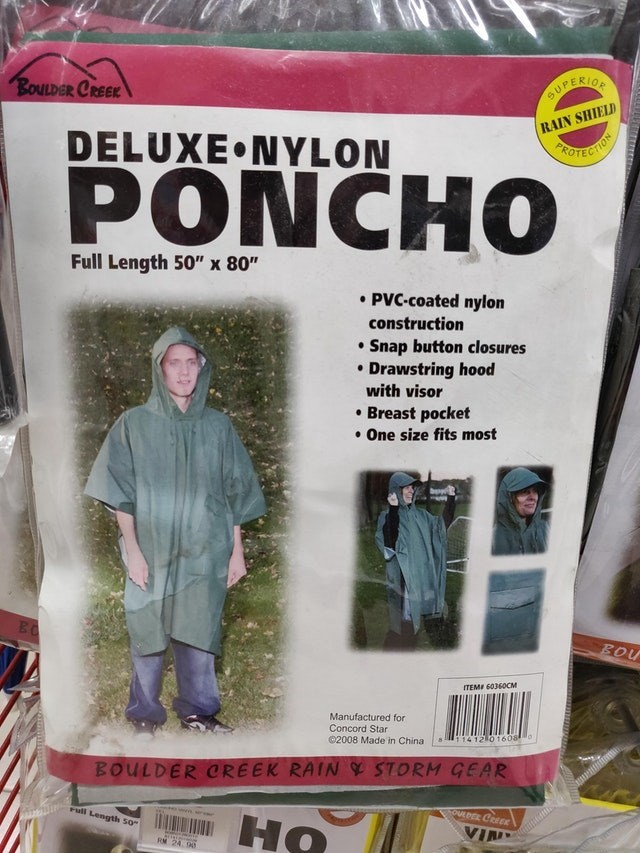 """Design - BOULDER CREEK SUPERION RAIN SHIELD DELUXE NYLON PROTECTION PONCHO Full Length 50"""" x 80"""" PVC-coated nylon construction Snap button closures Drawstring hood with visor Breast pocket One size fits most BOU ITEME 60360CM Manufactured for Concord Star 1412 0 1608 02008 Made in China s BOULDER CREEK RAIN S STORM GEAR ull Lengths 50 TOULDER CREE HO VIN RM 24. 9"""