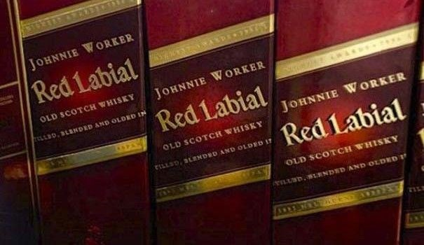 Text - JOHNNIE WORKER Red Labial OLD SCOTCH WHISKY JOHNNIE WORKER ALLLBD, BLBNDED AND OLDED IN Red 1abial JOHNNIE WORKER OLD SCOTCH WHISKY Red Labial tiLLSD, 3LENDED AND OLDED 1 OLD SCOTCH WHISKY rLUSD.BLENDED AND OLDED 1