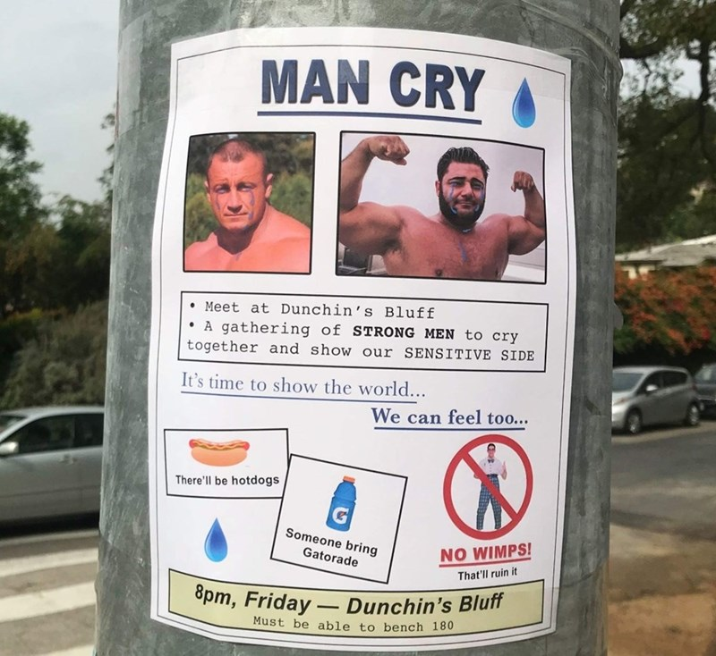 """Sign advertising """"Man Cry"""" where buff men get together and cry and show their sensitive sides"""