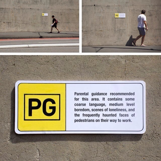 Text - PS PG Parental guidance recommended for this area. It contains some PG coarse language, medium level boredom, scenes of loneliness, and the frequently haunted faces of pedestrians on their way to work.