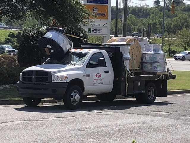 picture of truck after the load it was carrying fell forward and smashed its windshield in