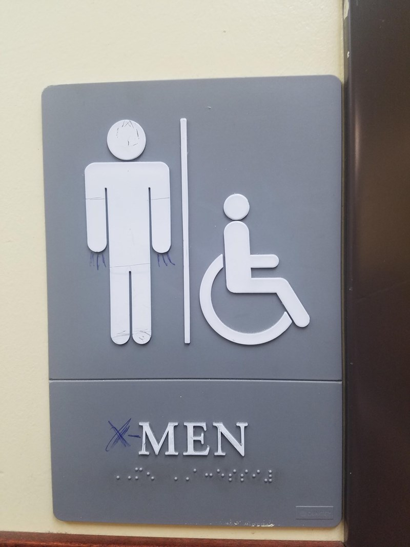 Men's room sign that's been turned into 'X-Men' - someone drew claws on the symbol for the man standing next to someone in a wheelchair