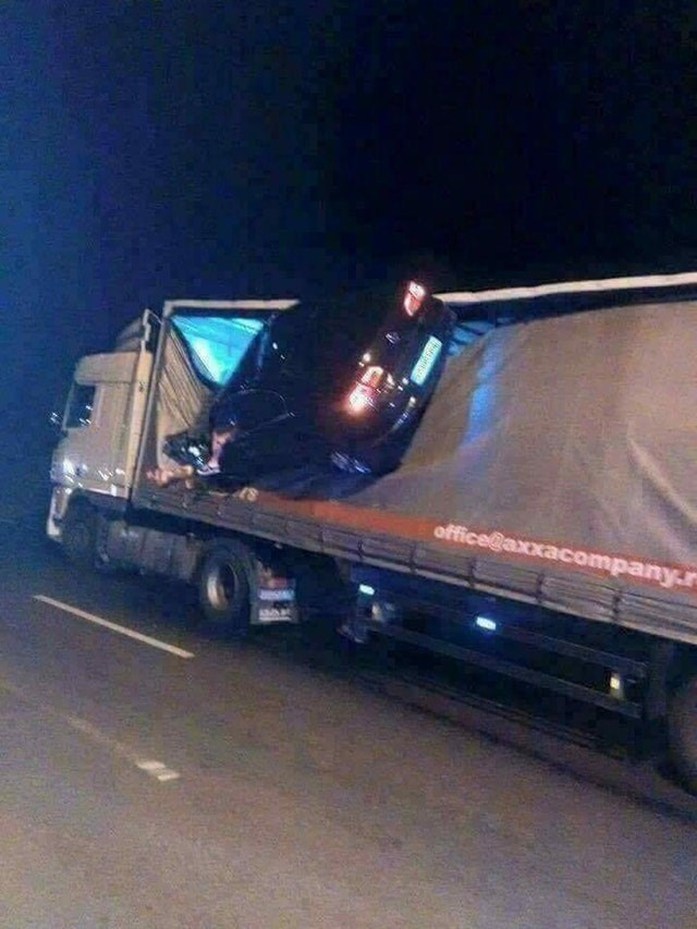 picture of car suspended in air after hitting loaded truck
