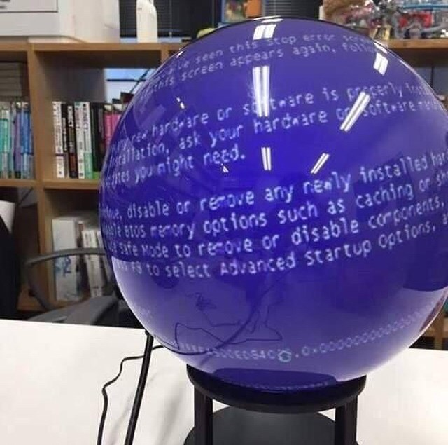 cursed image of crystal ball with blue screen of death
