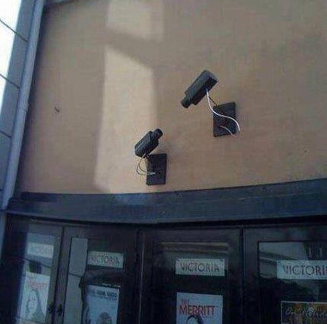 cursed image of two security cameras facing each other